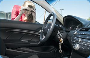 Picture of woman looking a her car keys locked inside her car