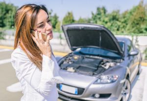 Picture of woman on phone seeking roadside assistance from RamblingWrecker-Manassas for her car.