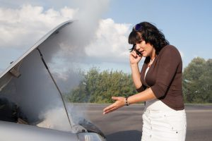 Picture of woman on the phone seeking help from the RamblingWrecker-Manassas for her overheated car.